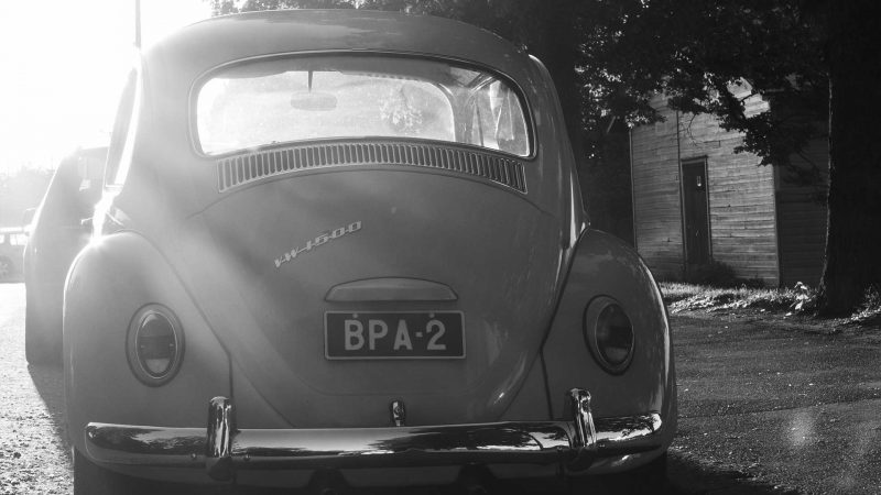 VW Beetle parked and facing the evening sun.